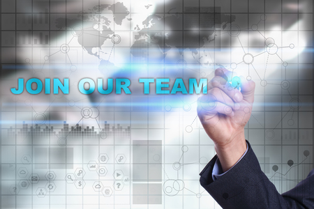 our company: Businessman is drawing on virtual screen. join our team concept. Stock Photo