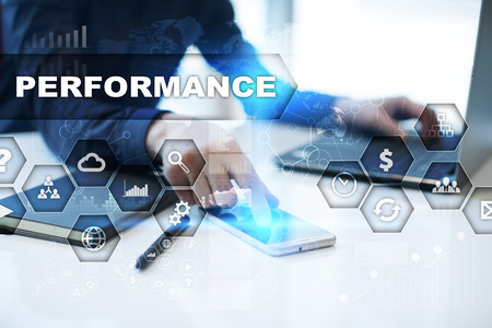 business performance: Businessman is working in office, pressing button on virtual screen and selecting performance