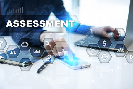 assessments: Businessman is working in office, pressing button on virtual screen and selecting assessment