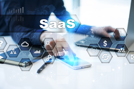 Businessman is working in office, pressing button on virtual screen and selecting saas