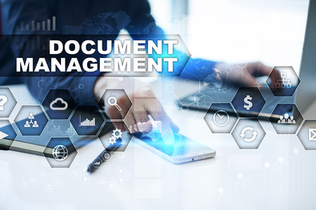 document management: Businessman is working in office, pressing button on virtual screen and selecting document management