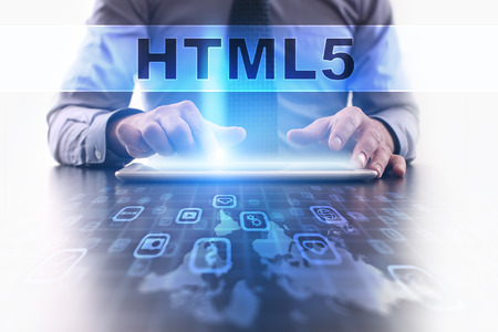 html5: html5 concept. Businessman working with modern tablet pc. Stock Photo