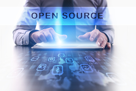 open source: open source concept. Businessman working with modern tablet pc. Stock Photo