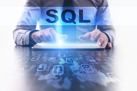 sql: sql concept. Businessman working with modern tablet pc.