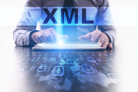 xml: xml concept. Businessman working with modern tablet pc.