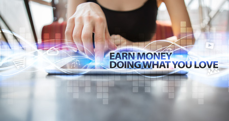 earn money: Woman using tablet pc and selecting earn money doing what you love.