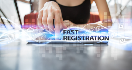 selecting: Woman using tablet pc and selecting fast registration.