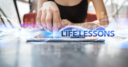 lessons: Woman using tablet pc and selecting life lessons. Stock Photo