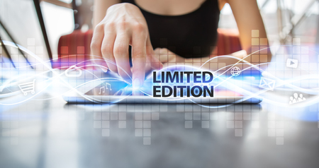 exclusively: Woman using tablet pc and selecting limited edition. Stock Photo