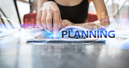 selecting: Woman using tablet pc and selecting planning.