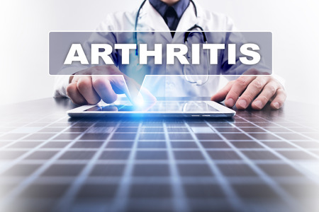 spondylitis: Medical doctor working with modern computer and selecting arthritis. Medical concept.