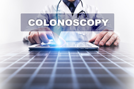 colonoscopy: Medical doctor working with modern computer and selecting colonoscopy. Medical concept.