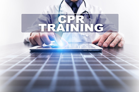 selecting: Medical doctor working with modern computer and selecting cpr training. Medical concept.