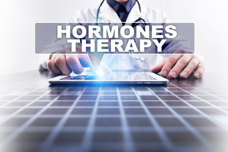 hormones: Medical doctor working with modern computer and selecting hormones therapy. Medical concept.