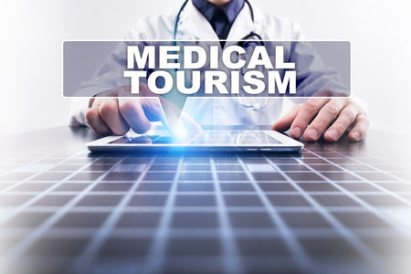medical doctors: Medical doctor working with modern computer and selecting medical tourism. Medical concept.