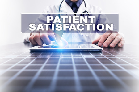 Medical doctor working with modern computer and selecting patient satisfaction. Medical concept.