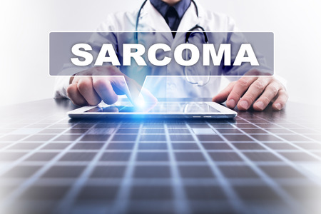 submucosa: Medical doctor working with modern computer and selecting sarcoma. Medical concept.