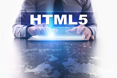 html5: Businessman is using tablet pc, pressing on virtual screen and selecting html5.