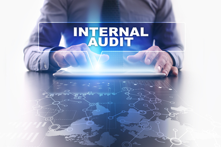 internal audit: Businessman is using tablet pc, pressing on virtual screen and selecting internal audit.