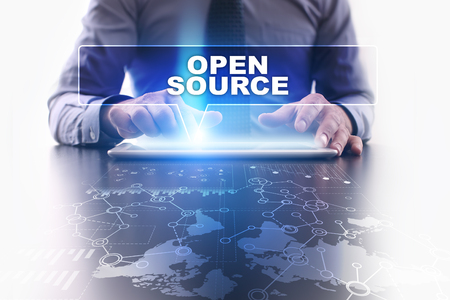 open source: Businessman is using tablet pc, pressing on virtual screen and selecting open source. Stock Photo