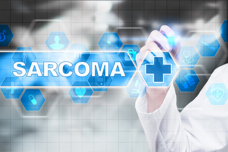 submucosa: Medical doctor drawing sarcoma on the virtual screen. Stock Photo
