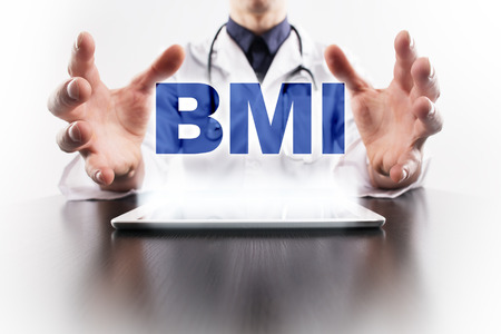 BMI: Medical doctor using tablet PC with bmi medical concept.