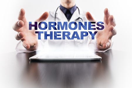 hormonas: Medical doctor using tablet PC with hormones therapy medical concept. Foto de archivo