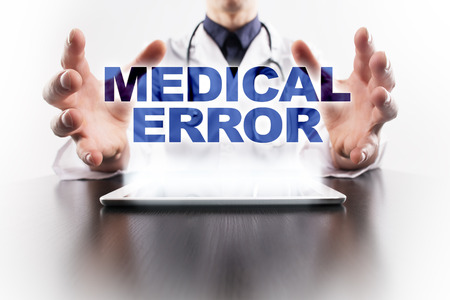 virtual assistant: Medical doctor using tablet PC with medical error medical concept.