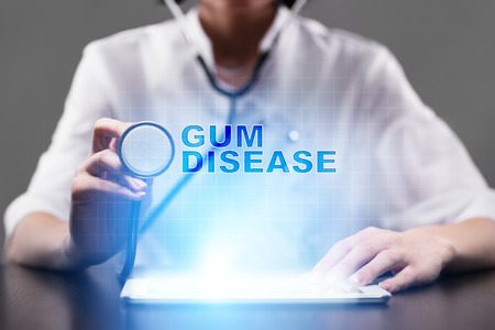 Periodontitis: Medical doctor working with modern computer and pressing button gum disease. Medical concept. Stock Photo
