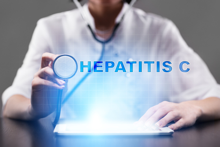 Medical doctor working with modern computer and pressing button hepatitis c. Medical concept.
