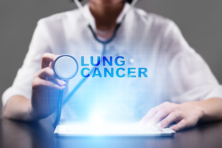 Medical doctor working with modern computer and pressing button lung cancer. Medical concept.