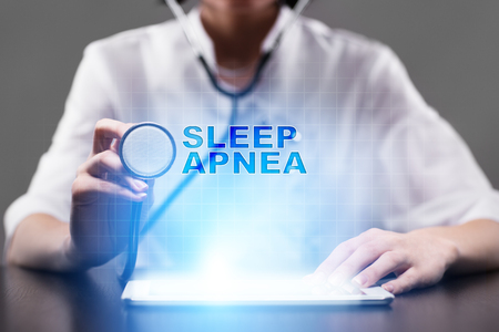 somnambulism: Medical doctor working with modern computer and pressing button sleep apnea. Medical concept. Stock Photo
