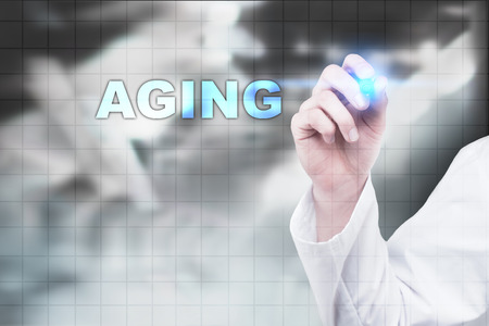 Medical doctor drawing aging on virtual screen.