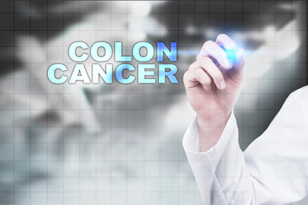 rectal: Medical doctor drawing colon cancer on virtual screen.