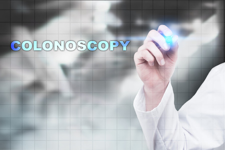 colonoscopy: Medical doctor drawing colonoscopy on virtual screen.