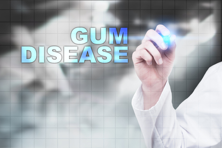 word of mouth: Medical doctor drawing gum disease on virtual screen.