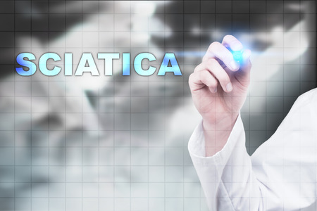 Medical doctor drawing sciatica on virtual screen.