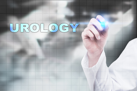 urologist: Medical doctor drawing urology on virtual screen.