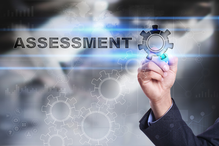 assessments: Businessman is drawing on virtual screen. assessment concept