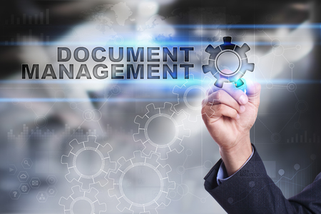 document management: Businessman is drawing on virtual screen. document management concept