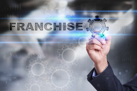 franchising: Businessman is drawing on virtual screen. franchise concept Stock Photo