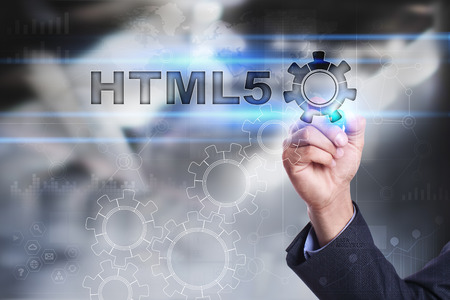 Businessman is drawing on virtual screen. html5 concept Stock Photo