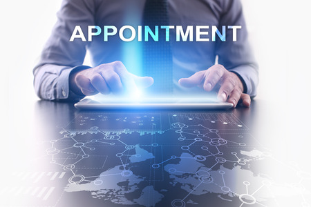 appointment: Businessman is using tablet pc and selecting appointment.