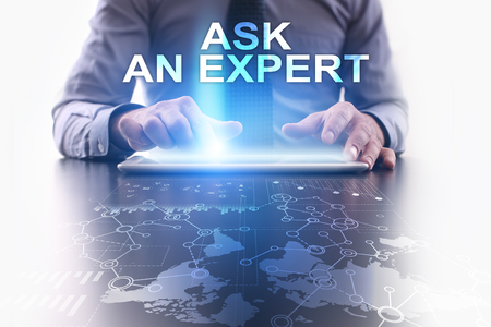 Businessman is using tablet pc and selecting ask an expert. Stock Photo