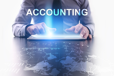 contaduria: Businessman is using tablet pc and selecting accounting.
