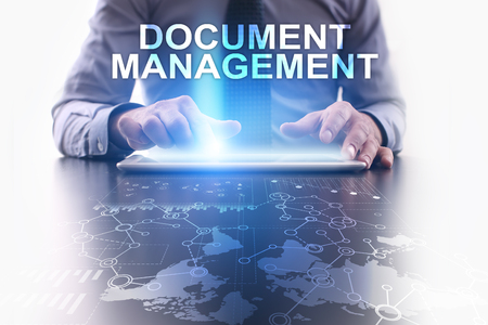 document management: Businessman is using tablet pc and selecting document management.