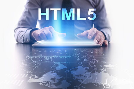 Businessman is using tablet pc and selecting html5.