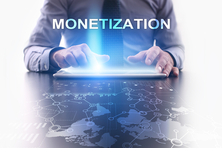 Businessman is using tablet pc and selecting monetization. Stock Photo