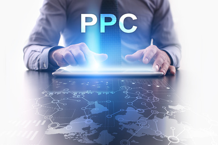 Businessman is using tablet pc and selecting ppc.