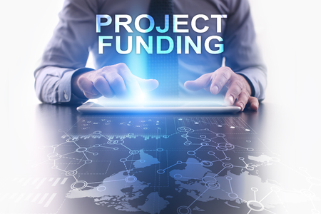 Businessman is using tablet pc and selecting project funding.